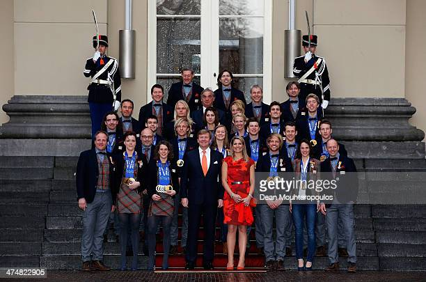 King WillemAlexander of the Netherlands and Queen Maxima of the Netherlands pose with all the Dutch gold medalist from the Sochi Winter Olympic at...