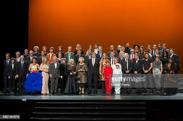 King WillemAlexander of The Netherlands and Queen Maxima of The Netherlands pose in a group photo with all performing artists during festivities...