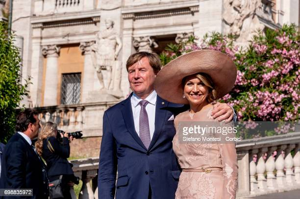 King Willem-Alexander of The Netherlands and Queen Maxima of The Netherlands pose in front of Rome City Hall after a visit at Rome's mayor Virginia...