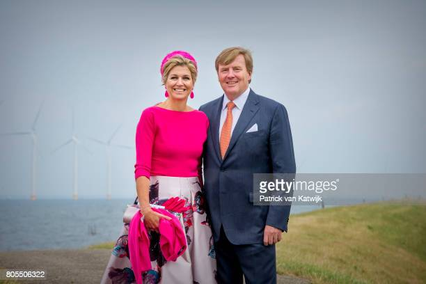 King WillemAlexander of The Netherlands and Queen Maxima of The Netherlands pose in front of the wind mills on June 29 2017 in Noordoostpolder...