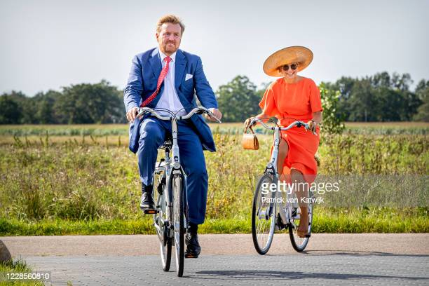 King Willem-Alexander of The Netherlands and Queen Maxima of The Netherlands ride on bicycles as they visit ECOstyle, Biosintrum and EcoMinutypark...