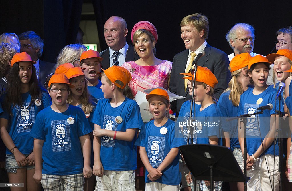 King Willem-Alexander of The Netherlands and Queen Maxima of The Netherlands sing with a choir before officially kicking off celebrations for the 750th anniversary of Goor during an official visit to the town centre on June 19, 2013 in Goor, Netherlands.