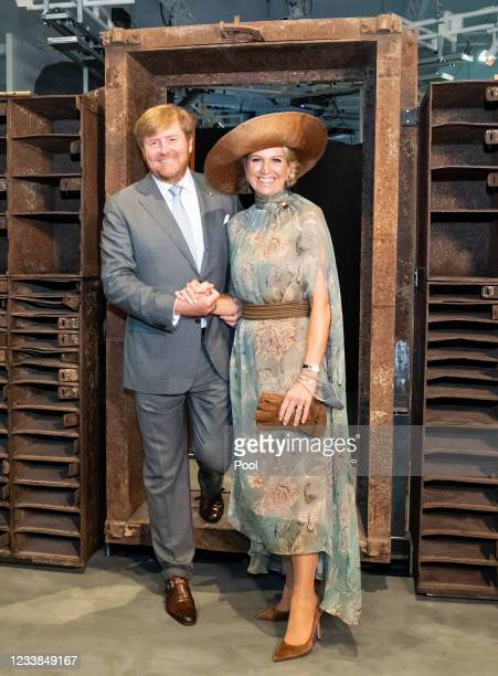 King Willem-Alexander of The Netherlands and Queen Maxima of The Netherlands step through the entrance door of former night club 'Tresor' during a...
