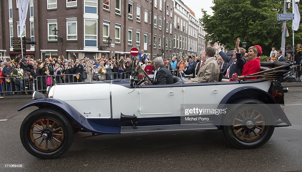 King Willem-Alexander of The Netherlands and Queen Maxima of The Netherlands take a ride in a classic car during their visit to The Hagueon June 21, 2013 in The Hague, Netherlands.