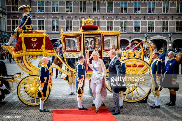A woman with dolls of the royals on a carriage is pictured during the Prinsjesdag on September 18 in The Hague Netherlands The Prinsjesdag the...