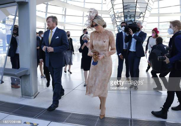 King Willem-Alexander of the Netherlands and Queen Maxima of the Netherlands visit the cupola of the Reichstag on July 06, 2021 in Berlin, Germany....