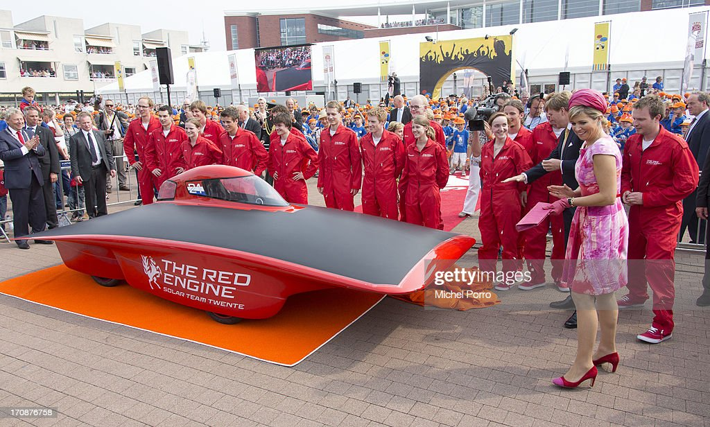 King Willem-Alexander of The Netherlands and Queen Maxima of The Netherlands unveil the Red Engine Solar Team Twente solar car during an official visit to the town centre on June 19, 2013 in Goor, Netherlands.