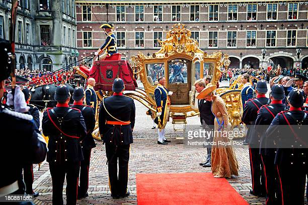 King WillemAlexander of The Netherlands and Queen Maxima of The Netherlands salute the military standard during celebrations for Prinsjesdag on...