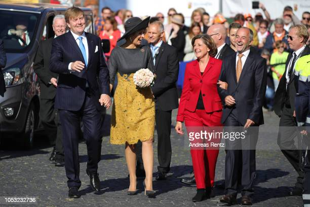 King WillemAlexander of The Netherlands and Queen Maxima of The Netherlands walk beside Governor of RhinelandPalatinate Malu Dreyer and her husband...
