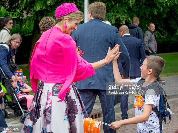King WillemAlexander of The Netherlands and Queen Maxima of The Netherlands walk through the neighbourhood of Nagele during their region visit to...