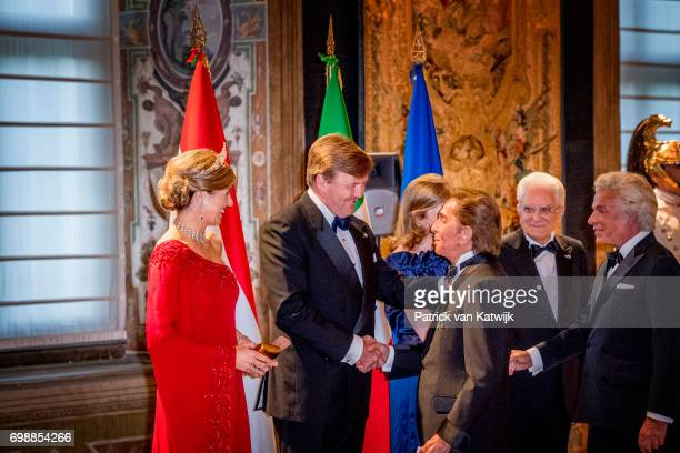 King Willem-Alexander of The Netherlands and Queen Maxima of The Netherlands with designer Valentino Garavani attend the official state banquet...