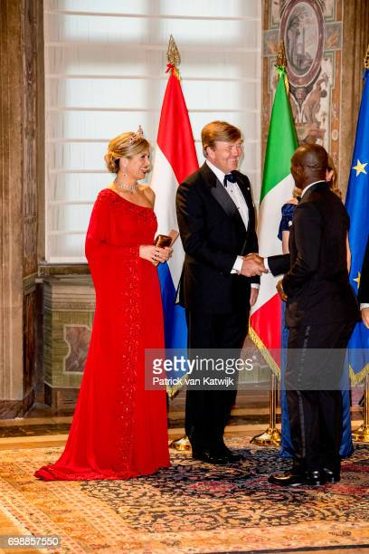 King Willem-Alexander of The Netherlands and Queen Maxima of The Netherlands with Clarence Seedorf attend the official state banquet presented by...