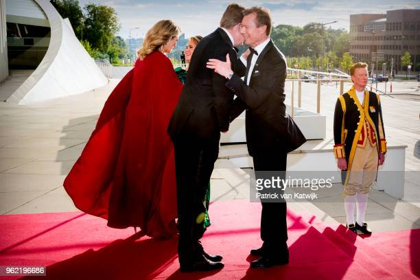 King WillemAlexander of The Netherlands and Queen Maxima of The Netherlands with Grand Duke Henri and Grand Duchess Maria Teresa attend a concert...