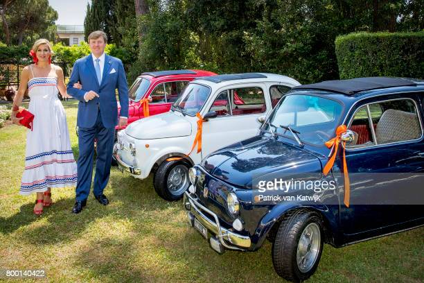 King WillemAlexander of The Netherlands and Queen Maxima pose in the front of Fiat 500 in the colours of the Dutch flag at the residence of the Prime...