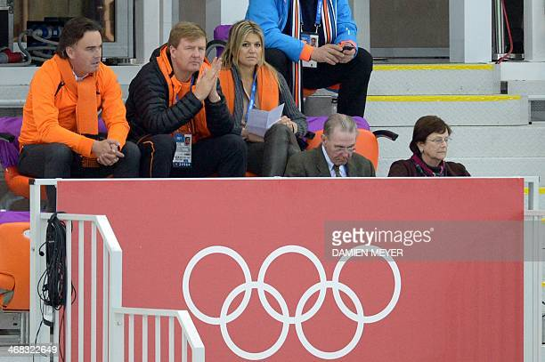 King WillemAlexander of the Netherlands and Queen Maxima watch the Men's Speed Skating 500 m at the Adler Arena during the Sochi Winter Olympics on...