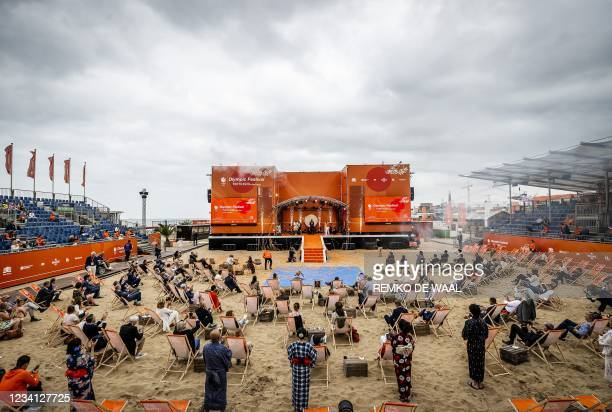 King Willem-Alexander of the Netherlands applauses on stage during the opening of TeamNL Olympic Festival on the sports beach in Scheveningen, in the...