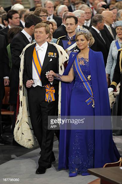 King WillemAlexander of the Netherlands arrives with his wife Queen Maxima for his inauguration ceremony on April 30 2013 at Nieuwe Kerk in Amsterdam...