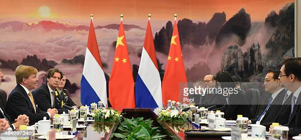 King Willem-Alexander of the Netherlands attends a meeting with Chinese Premier Li Keqiang at the Great Hall of the People on October 26, 2015 in...