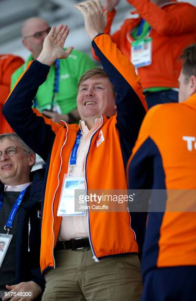 King Willem-Alexander of the Netherlands celebrates the gold medal of Ireen Wust and the bronze medal of Marrit Leenstra in the Speed Skating Ladies'...