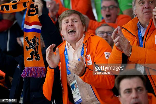 King WillemAlexander of the Netherlands celebrates the gold medal of Ireen Wust and the bronze medal of Marrit Leenstra in the Speed Skating Ladies'...