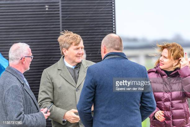 King WillemAlexander of The Netherlands deputy Bert Borman of the Province Overijssel and Cora van Nieuwenhuizen Minister of Infrastructure and Water...