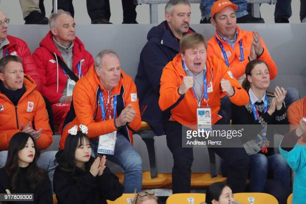 King WillemAlexander of the Netherlands gestures during the race of Kjeld Nuis of the Netherlands during the Men's 1500m Speed Skating on day four of...