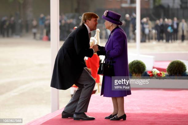 King WillemAlexander of the Netherlands greets Queen Elizabeth II upon his arrival to inspect an honour guard during a Ceremonial Welcome on Horse...