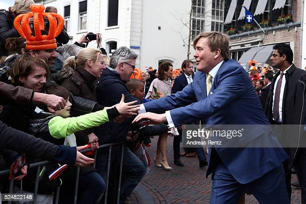 King Willem-Alexander of The Netherlands greets spectators during King's Day , the celebration of the birthday of the Dutch King, on April 27, 2016...