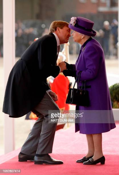 King WillemAlexander of the Netherlands is greeted by Britain's Queen Elizabeth II during a Ceremonial Welcome on Horse Guards Parade in London on...