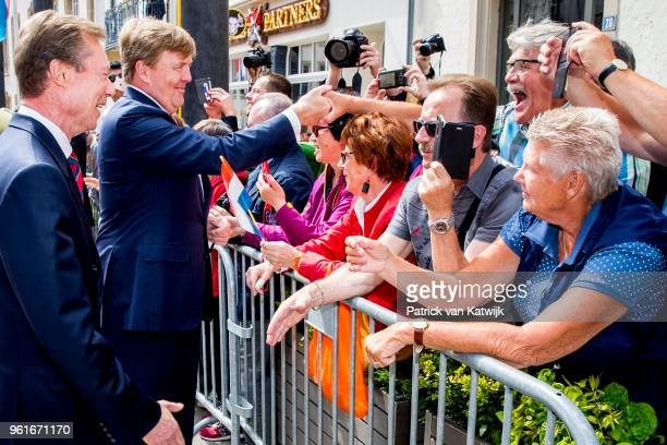 King Willem-Alexander of The Netherlands is welcomed by Grand Duke Henri of Luxembourg with an official welcome ceremony on May 23, 2018 in...