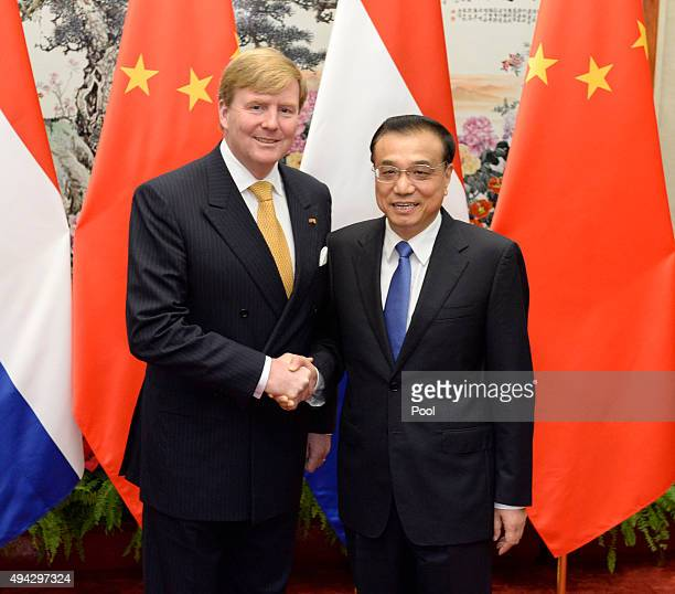 King WillemAlexander of the Netherlands meets Chinese Premier Li Keqiang ahead of their talks at the Great Hall of the People on October 26 2015 in...