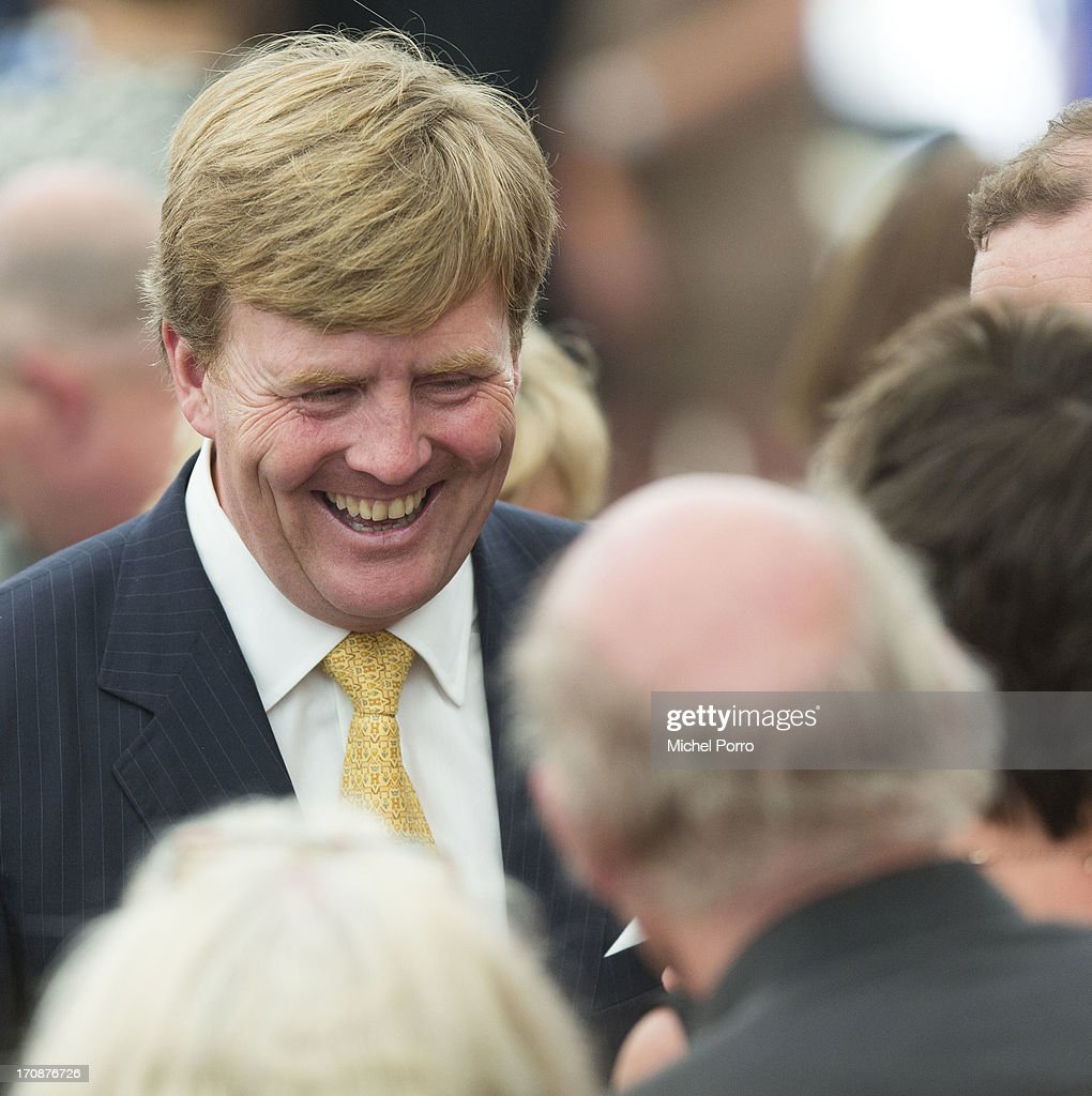 King Willem-Alexander of The Netherlands meets with people during an official visit to the town centre on June 19, 2013 in Goor, Netherlands.