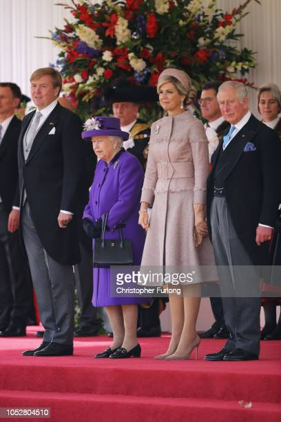 King WillemAlexander of the Netherlands Queen Elizabeth II Queen Maxima of the Netherlands and Prince Charles Prince of Wales are seen during a...