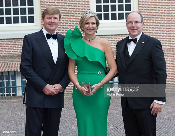 King WillemAlexander of The Netherlands Queen Maxima of The Netherlands and Prince Albert II of Monaco arrive for dinner at the Loo Royal Palace on...