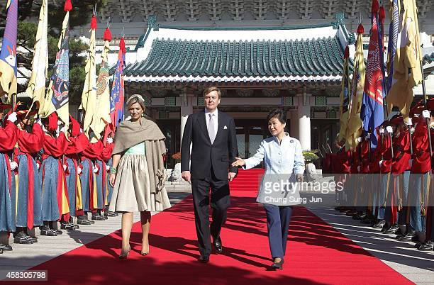 King Willem-Alexander of The Netherlands, Queen Maxima of The Netherlands and South Korean President Park Geun-Hye walk towards a guard of honour...