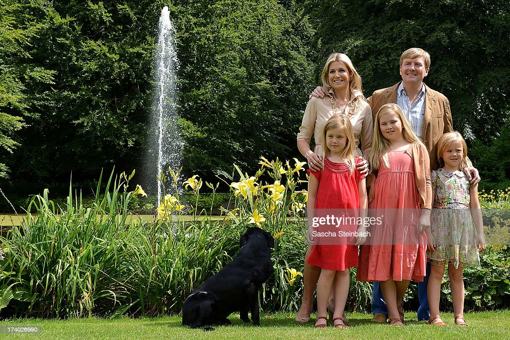 King Willem-Alexander of the Netherlands, Queen Maxima of the Netherlands, Crown Princess Catharina-Amalia of the Netherlands, Princess Alexia of the Netherlands and Princess Ariane of the Netherlands with their dog 'Skipper' pose during the annual summer photocall at Horsten Estate on July 19, 2013 in Wassenaar, Netherlands.