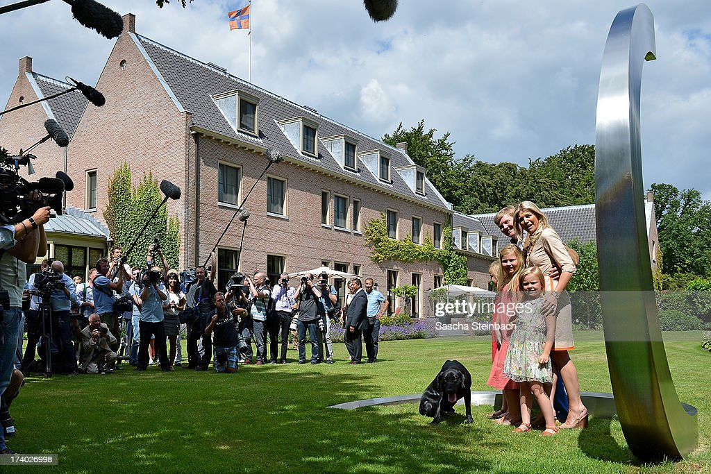 King Willem-Alexander of the Netherlands, Queen Maxima of the Netherlands, Crown Princess Catharina-Amalia of the Netherlands, Princess Alexia of the Netherlands and Princess Ariane of the Netherlands pose with their dog 'Skipper' for media during the annual summer photocall at Horsten Estate on July 19, 2013 in Wassenaar, Netherlands.