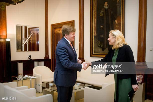 King WillemAlexander of The Netherlands shakes hands with Dutch Minister of Foreign Trade and Development Cooperation Sigrid Kaag at the Royal Palace...