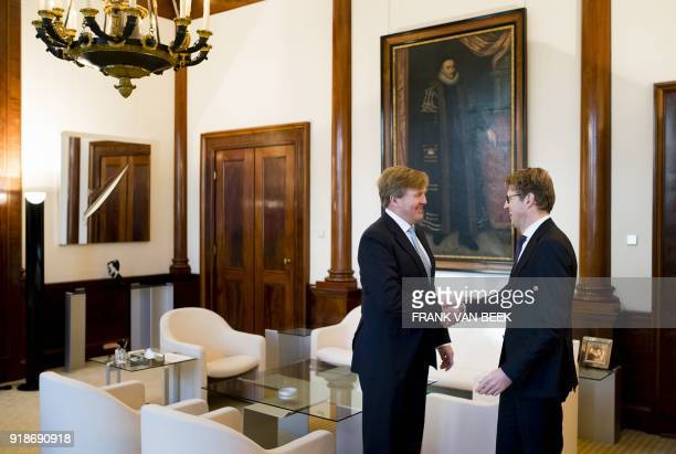 King WillemAlexander of The Netherlands shakes hands with Dutch Minister of Safety Sander Dekker prior to their meeting at the Royal Palace...