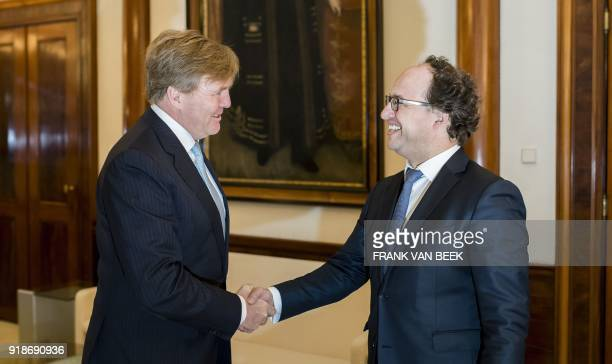 King WillemAlexander of The Netherlands shakes hands with Dutch Minister of Social Affairs Wouter Koolmees prior to their meeting at the Royal Palace...