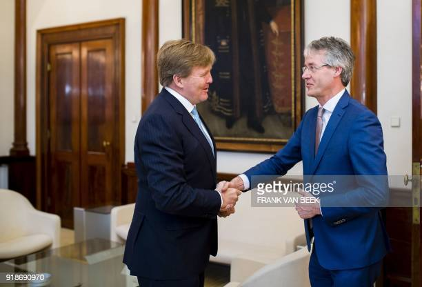 King WillemAlexander of The Netherlands shakes hands with Dutch Minister of Education Culture and Science Arie Slob at the Royal Palace Noordeinde in...