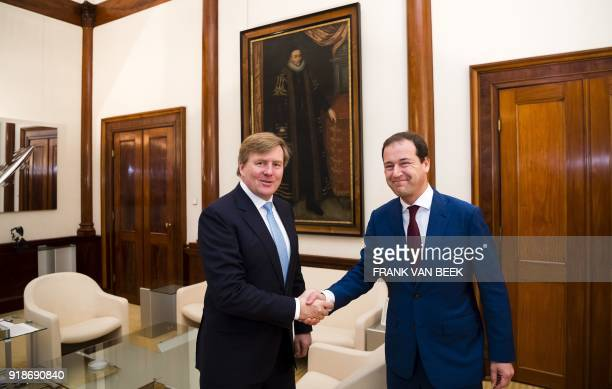 King WillemAlexander of The Netherlands shakes hands with PvdA party leader Lodewijk Asscher prior to their meeting at the Royal Palace Noordeinde in...