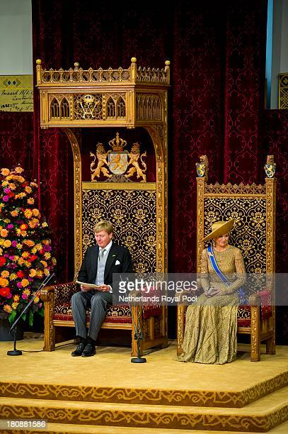 King WillemAlexander of The Netherlands sits next to Queen Maxima of The Netherlands as he reads his first budget speech during celebrations for...