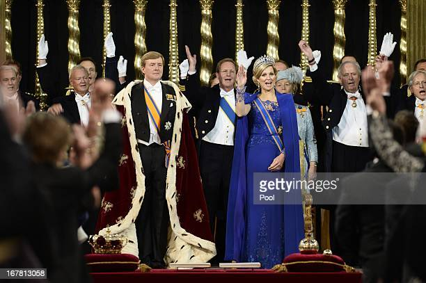 King WillemAlexander of the Netherlands stands alongside HM Queen Maxima of the Netherlands during his swearing in and investiture ceremony in front...