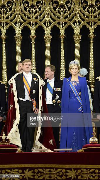 King Willem-Alexander of the Netherlands stands alongside Queen Maxima of the Netherlands during his swearing in and investiture ceremony in front of...