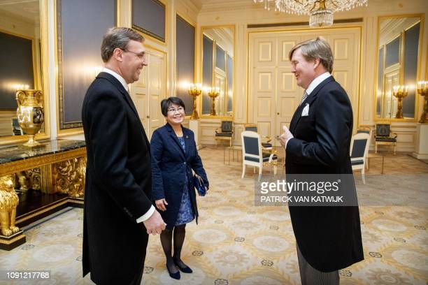 King Willem-Alexander of The Netherlands stands before Dutch diplomat Adriaan Palm during his inauguration as Dutch Ambassador to Republic of Ireland...