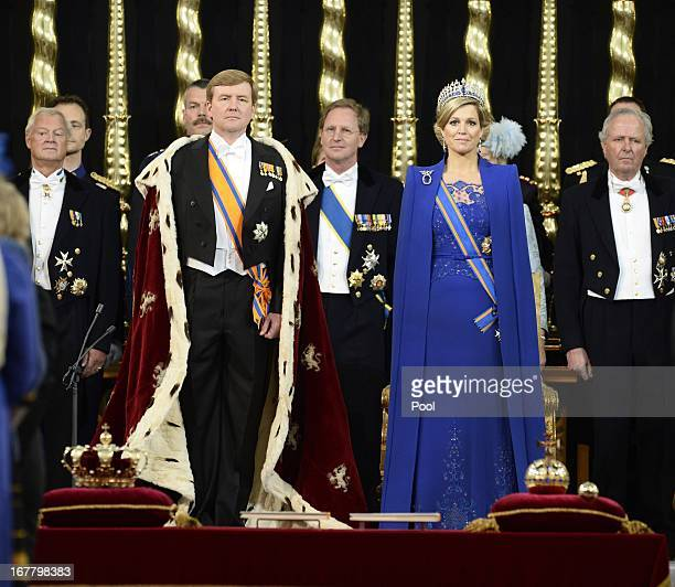 King WillemAlexander of the Netherlands takes an oath as he stands alongside Queen Maxima of the Netherlands during his swearing in and investiture...