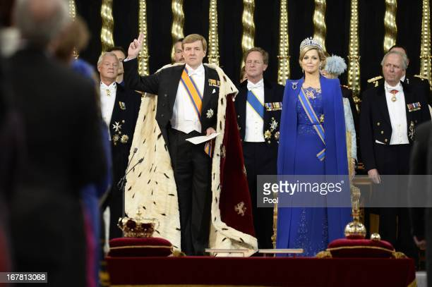King WillemAlexander of the Netherlands takes an oath as he stands alongside HM Queen Maxima of the Netherlands during his swearing in and...