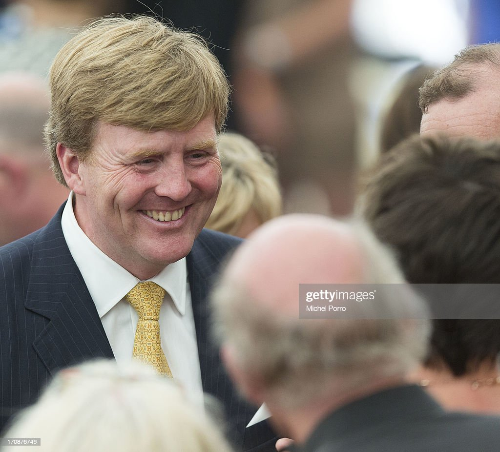 King Willem-Alexander of The Netherlands talks with people during an official visit to the town centre on June 19, 2013 in Goor, Netherlands.