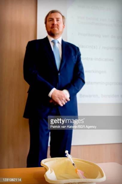 King Willem-Alexander of The Netherlands visits the GGD Corona Vaccination XL location on February 9, 2021 in Houten, Netherlands.